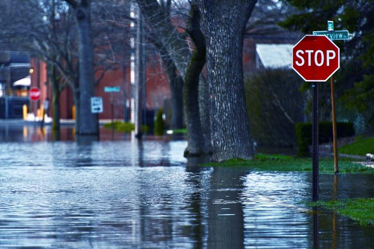 Flooded Street of Des Plains City. Spring River Flood. Des Plains, IL, USA. Nature Disasters Photo Collection.