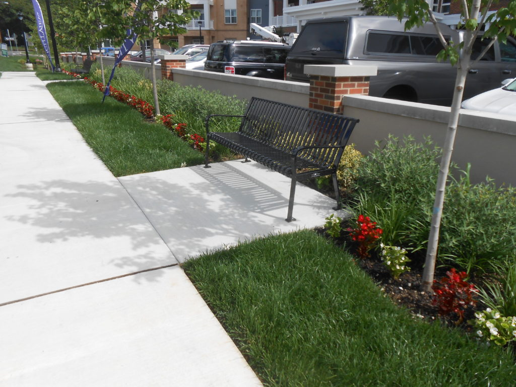 Senior Living Design Trends - Landscaped sidewalk and seating area